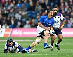 Samoa's TJ Loane breaks through the tackle of Scotland's Willem Nel during the Autumn International at BT Murrayfield, Edinburgh.