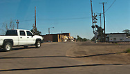 A pickup truck approaches a railroad grade crossing at a small west Texas village along Interstate 20