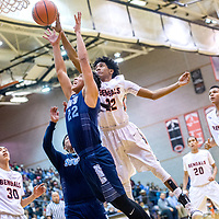 Window Rock Scout Burk Williams (22) is blocked by Gallup Bengal Zakarri Fields (22) during the Bengal Boys Basketball Invitational Tournament third-place game at Gallup High School Saturday.