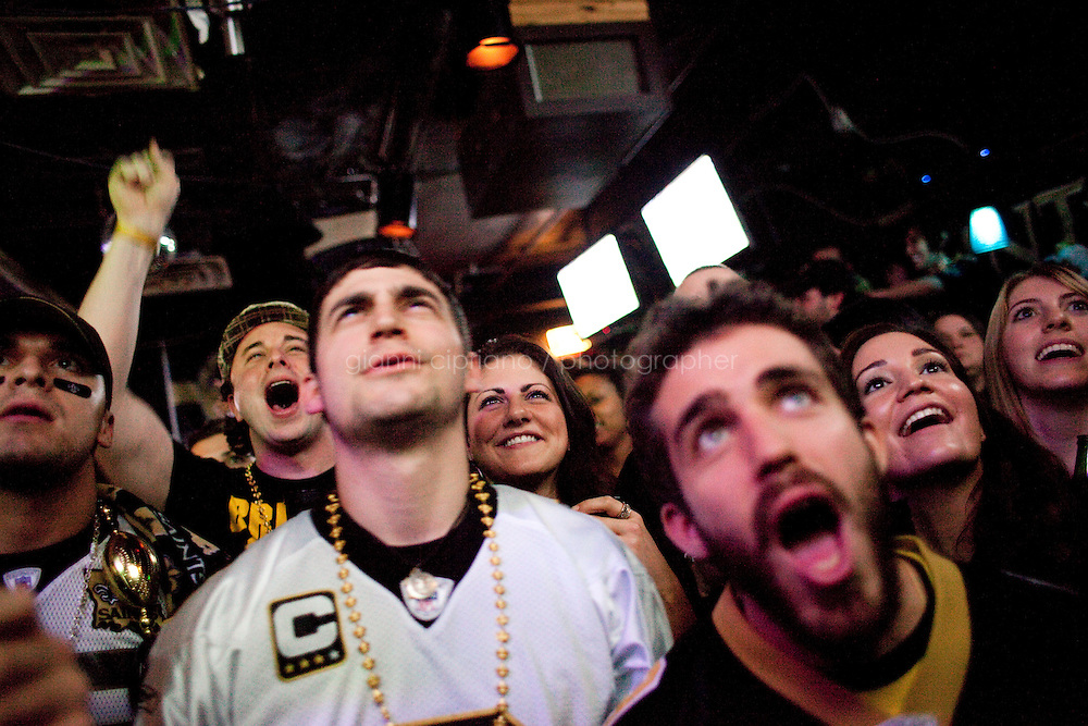 24 January, 2009. New York NY. New Orleans Saints and Minnesota Vikings fans watch the football game at Bar None in the East Village. Bar None is a bar for both Saints and Vikings fans.<br /> <br /> ©2009 Gianni Cipriano<br /> cell. +1 646 465 2168 (USA)<br /> cell. +39 328 567 7923<br /> gianni@giannicipriano.com<br /> www.giannicipriano.com