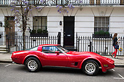 Red Corvette vintage sports car parked outside a home in Knightbridge. In a selected few boroughs of West London, wealth has changed over the last couple of decades. Traditionally wealthy parts of town, have developed into new affluent playgrounds of the super rich. With influxes of foreign money in particular from the Middle-East. The UK capital is home to more multimillionaires than any other city in the world according to recent figures. Boasting a staggering 4,224 'ultra-high net worth' residents - people with a net worth of more than $30million, or £19.2million.. London, England, UK.