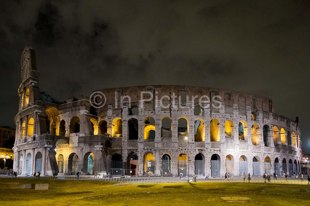 Roman Coliseum at night, Rome, Italy.