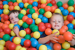 Boys playing in the ball pit at an early start nursery; ran by the Nottingham Royal Society for the Blind (NRSB),