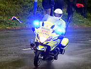 A police motorcyclist braves the heavy rain to patrol Baggaby Hill during Stage 1 of the Tour de Yorkshire from Doncaster to Selby, Doncaster, United Kingdom on 2 May 2019.