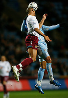 Photo: Steve Bond.<br />Coventry City v West Ham United. Carling Cup. 30/10/2007. Anton ferdinand beats Leon Best to a goalmouth header