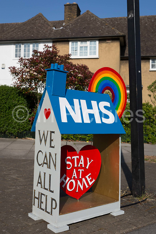 As the UK governments lockdown restrictions during the Coronavirus pandemic continues, and number of UK reported cases rose to 138,078 with a total now of 18,738 deaths, a locally constructed representation of an NHS house, a model of acknowledgement and support for NHS National Health Service care workers, outside a Homes For Heroes for WW1 veterans at the top of the Casino Avenue estate in Herne Hill, on 23rd April 2020, in London, England.