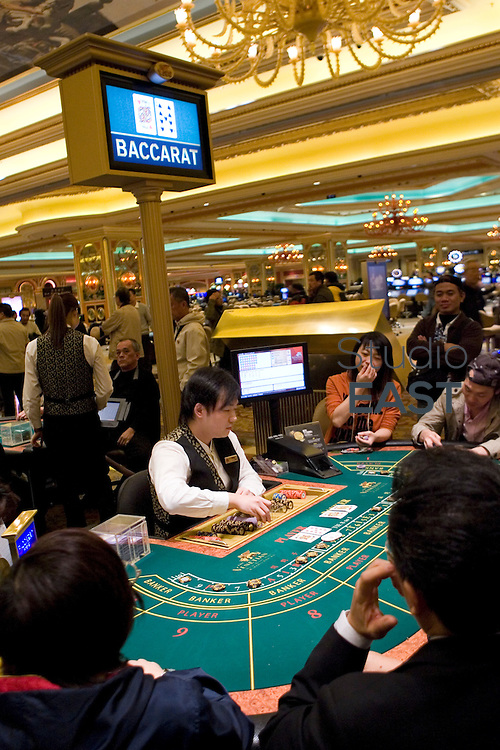 MACAO, CHINA - December 17: Gamblers play Baccarat in Venetian casino on December 17, 2009 in Macao, China. (Photo by Lucas Schifres/Getty Images)
