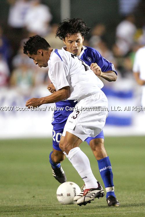 27 March 2007: Honduras's Iván Guerrero (23) blocks the path of El Salvador's William Antonio Torres (20). The National Team of Honduras defeated the National Team of El Salvador 2-0 at SAS Stadium in Cary, North Carolina in an International Friendly soccer match.