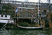 Radio Baskerville sign on canal boat next to derelict building, Amsterdam 1973