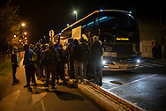 Migrants wait to get on bus towards Tours that stops in front of Pausa reception centre. Baiona (Basque Country). March 12, 2021. Pausa is a reception centre open to migrants to have a recovery time before continuing to northern Europe. Is the next step for most migrants who stop in irun. (Gari Garaialde / Bostok Photo)