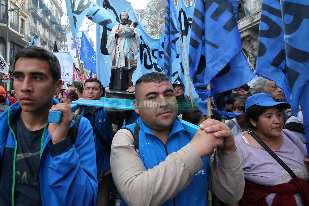 August 7, 2017 - Buenos Aires, Buenos Aires, Argentina - Social and political organizations march in protest during the religious festival of San Cayetano. The organizations claim the government ''the immediate sanction of the Food Emergency Law. (Credit Image: © Claudio Santisteban via ZUMA Wire)