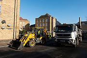 Road resurfacing work on a street in Wapping, London, England, United Kingdom.