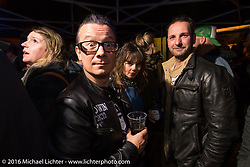 Sebastien Lorentz of Lucky Cats and Sultans of Sprint with his lovely girlfriend Lolo  at the Booze Bon party at the Amadeus Speed Shop after a long day at the Intermot Motorcycle Trade Fair. Cologne, Germany. Saturday October 8, 2016. Photography ©2016 Michael Lichter.