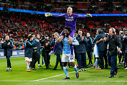 Wilfredo Caballero of Manchester City is lifted by Wilfried Bony after his saves in the penalty shootout help his side win the match and the Capital One Cup - Mandatory byline: Rogan Thomson/JMP - 28/02/2016 - FOOTBALL - Wembley Stadium - London, England - Liverpool v Manchester City - Capital One Cup Final.