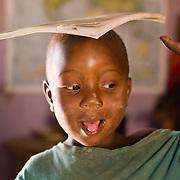 Little Djibi tests his balancing skills. Koumbadiouma, Kolda, Senegal.