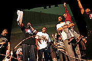 Artists and spectators are taking part together to the final moments on stage of the 'Palestine - The Album', a music collection recorded by many different artists in the Islamic Hip Hop scene in London, England, on Saturday, Jan. 6, 2007.  Islamic Hip Hop artists like the duo 'Blind Alphabetz', from London, feel more than ever the need to say what they think aloud. In the music industry the backlash of a disputable Western foreign policy towards Islamic countries and its people is strong. The number of artists in the European Union and the US taking this into consideration and addressing the current social and political problems within their lyrics is growing rapidly and fostering awareness for Muslim and others alike.