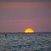 Watching the sun bid the day adieu over Sanibel Island from Ft Myers Beach