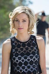 beautiful woman and an approaching cowboy outdoors