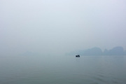 © Licensed to London News Pictures. 31/12/2011. A junk in the sea mist at Halong Bay, Vietnam. Photo credit : Stephen Simpson/LNP