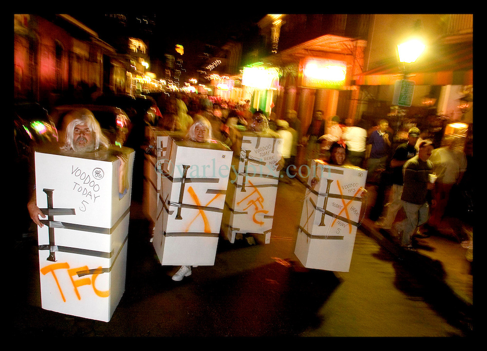 October 31st, 2005. Halloween, post Katrina, New Orleans. As the city returns to a strange sense of normalcy and the citizens return, New Orleans once again hosts a Halloween parade and party. The parade makes its way down Bourbon Street with participants dressed as refrigerators.