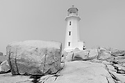 Lighthouse and rocky shoreline <br />