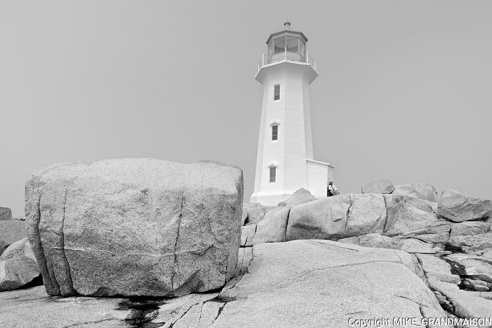 Lighthouse and rocky shoreline <br />Peggy's Cove<br />Nova Scotia<br />Canada