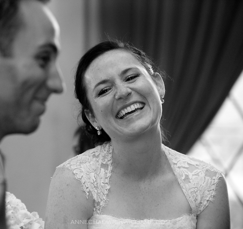 A bride smiles and the groom during a toast at the Berkeley City Club.