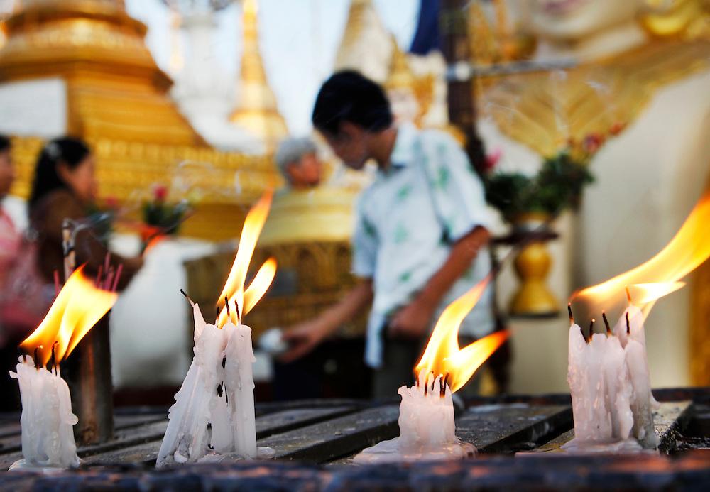 Buddhist and Nat worship devotional candles. The Shwedagon Pagoda complex, Yangon, Myanmar.