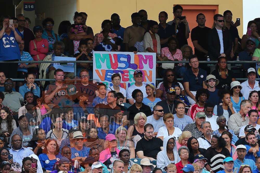 A Muslim veteran sign is seen as President Barack Obama campaigns for Democratic nominee Hillary Clinton at Osceola Park in Kissimmee Florida USA  06 Nov 2016