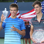 Borna Coric, Croatia, (left), with his trophy after defeating Thanasi Kokkinakis, Australia, during the Junior Boys' Singles Final at the US Open. Flushing. New York, USA. 8th September 2013. Photo Tim Clayton