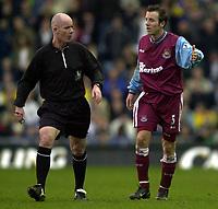 Photo: Greig Cowie<br />Barclaycard Premiership. Leeds United v West Ham United. 08/02/2002<br />Lee Bowyer protests to Dermot Gallagher