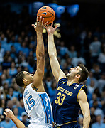 University of North Carolina forward Garrison Brooks wins the opening tip against Notre Dame forward John Mooney at the Dean E. Smith Center on January 15, 2019. The Tar Heels went on to win 75-69.