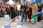 Her Majesty the queen and members of the royal family celebrate Saturday 29 April 2006 Queensday in the province flevoland in the cities  Zeewolde and almere.<br /> <br /> Hare Majesteit de Koningin en leden van de Koninklijke Familie vieren zaterdag 29 april 2006 Koninginnedag mee in de provincie Flevoland en wel in Zeewolde en Almere.<br /> <br /> On the Photo / Op dce foto: <br /> Queen Beatrix and major Jorritsma look with George Geutjes the portrait paints of CKV (centre artistic shaping) in almere / Koningin Beatrix en burgemeester Jorritsma bekijken samen met George Geutjes het portret schilderen van CKV (Centrum Kunstzinnige Vorming) in Almere.
