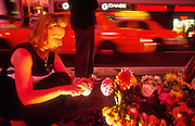 NEW YORK, NY: A woman lights a candle at a memorial in Times Square in Manhattan for people killed when the World Trade Center towers collapsed, Sept 20, 2001. Terrorists crashed two hijacked jetliners into the World Trade Center collapsing the towers on Sept 11, 2001, killing more 2,900 people.   PHOTO BY JACK KURTZ
