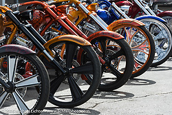 Colorful display of Eddie Trotta choppers by his booth on Main Street during Daytona Bike Week's 75th Anniversary event. FL, USA. Saturday March 12, 2016.  Photography ©2016 Michael Lichter.