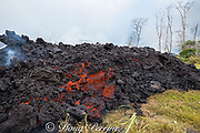 lava originating from Pu'u O'o on Kilauea Volcano, and emanating from a fissure in Leilani Estates, near Pahoa, Puna, Hawaii ( the Big Island ), Hawaiian Islands, U.S.A., enters a property off of Pohoiki Rd as a thick flow of a'a lava