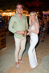 EDITORIAL USE ONLY Max Morley and Laura Anderson at the launch of Virgin Holidays Departure Beach in Barbados.