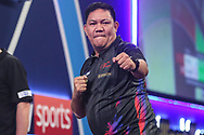 Noel Malicdem hits a double and wins a leg during the PDC William Hill World Darts Championship at Alexandra Palace, London, United Kingdom on 20 December 2019.