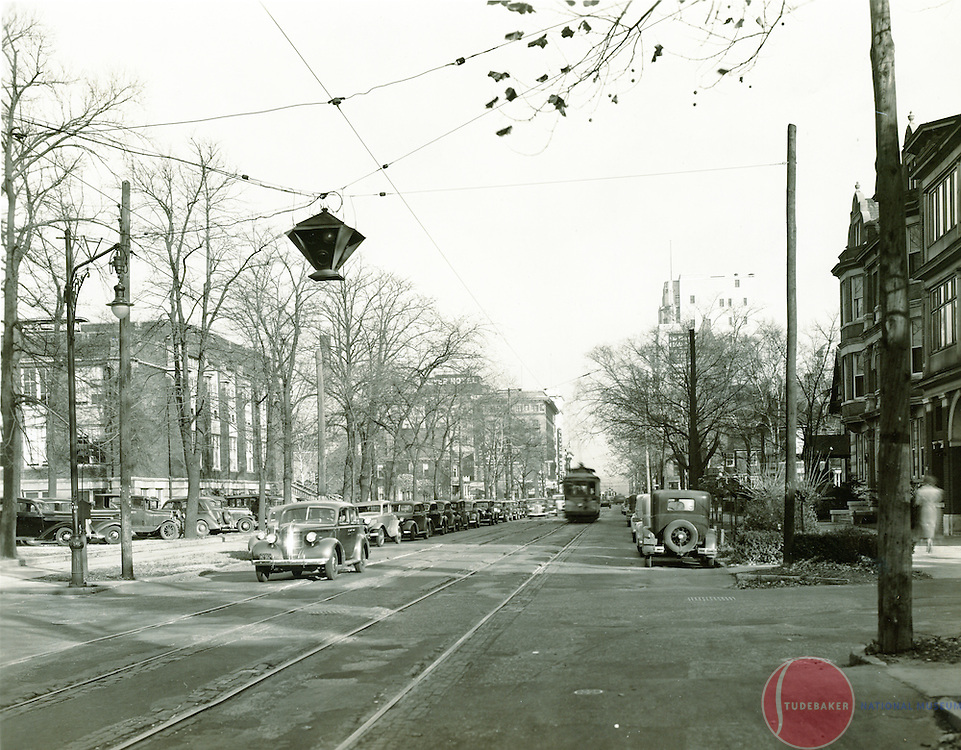 1938 image facing east on South Bend's West Washington Street. South Bend Central High School and the Oliver Hotel are visible in the background.