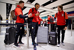 LONDON, ENGLAND - Sunday, March 18, 2018: Wales' James Chester, captain Ashley Williams and Joe Allen at Heathrow Airport as the team prepare to fly to Nanning for the 2018 Gree China Cup International Football Championship. (Pic by David Rawcliffe/Propaganda)