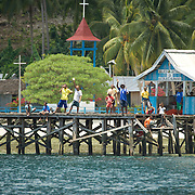 Papuan people on a jetty.