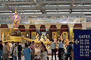 "Bangkok's brand new Suvarnabhumi airport. Scene of ""The Churning of the Milk Ocean"". Tourists taking souvenir photos."