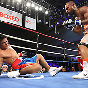 "Jonathan ""Pitbull"" Vidal (Grey shorts) knocks out Juan Kantun during a ""Boxeo Telemundo"" boxing match at the Kissimmee Civic Center on Friday, July 18, 2014 in Kissimmee, Florida.  Vidal won the bout by TKO. (AP Photo/Alex Menendez)"