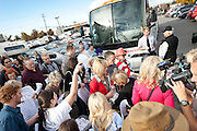 Mitt Romney supporters crowd around to get their Romney t-shirts at a pro-Romney rally and volunteer sendoff, Friday, Nov. 2, 2012.