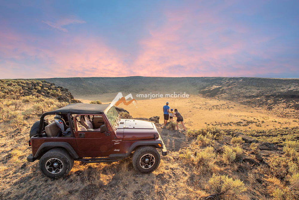 Family jeeping above the Dietrich Crater enjoying sunset. Dietrich, Idaho.