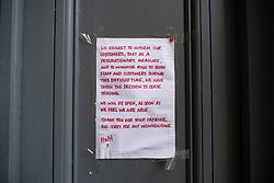 Edinburgh, Scotland, UK. 18 March 2020. Sign of door stating that coronavirus  has caused Halfway Pub in Fleshmarket Close to cease trading. Edinburg.. Iain Masterton/Alamy Live News.