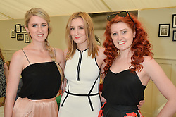 Left to right, sisters OLIVIA CARMICHAEL, LAURA CARMICHAEL and AMY CARMICHAEL at the St.Regis International Polo Cup at Cowdray Park, Midhurst, West Sussex on 16th May 2015.