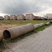 nieuwbouwwijk, woningen, rioolbuizen, pijpen, afezetting, wolken