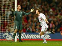 Fotball<br /> VM-kvalifisering<br /> Wales v Polen<br /> 13.10.2004<br /> Foto: BPI/Digitalsport<br /> NORWAY ONLY<br /> <br /> Wales v Poland. FIFA World Cup European Qualifying Group Six. Millenium Stadium. 13/10/2004.<br /> Thomasz Frankowski celebrates the helpless Paul Jones