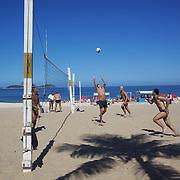 Locals play beach volleyball at Ipanema beach, Rio de Janeiro,  Brazil. 4th July 2010. Photo Tim Clayton....